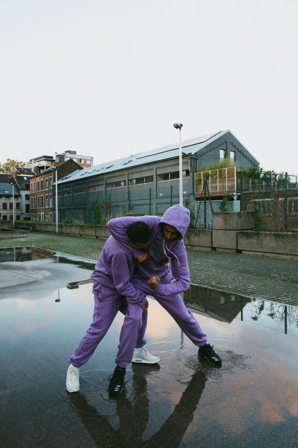 Stay-Calma-lilac-tracksuit-fight